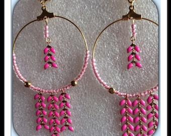 Pink hoop spike earrings.