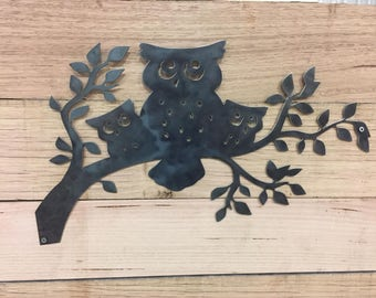 Owls sitting on a branch steel wall garden art sign