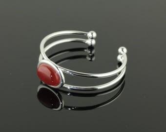 Silver plated bracelet with Carnelian oval gemstone.