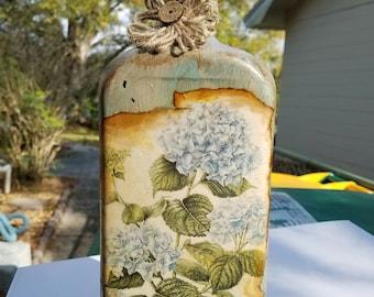 Decorated liquor bottle, painted/embellished