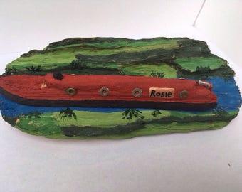 Handmade driftwood canal boat.