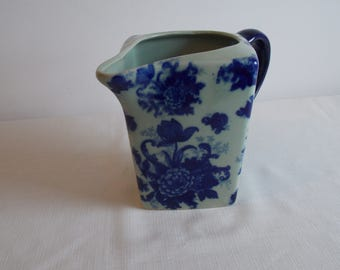 A flow blue pitcher.