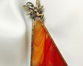 Handmade exclusive necklace with pendant made of flamed Tiffany glass with a fairy on top