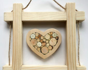 Floating pine frame with log heart on perspex