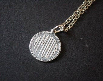 Silver tone Amour french coin necklace