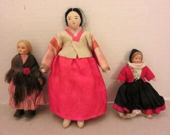 Three small size  nationality dolls
