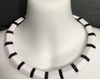 Plastic 80s black and white necklace.
