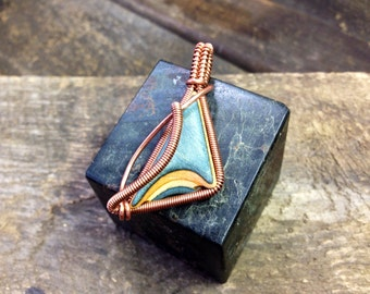 Wire wrapped skateboard wood pendant.