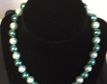 Green and white pearl necklace