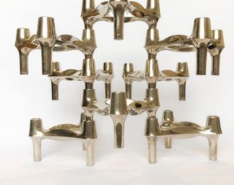 A vintage 1970's bundle of 8 stackable candle holders by Ceasar Stoffi & Fritz Nagel for BMF/Quist
