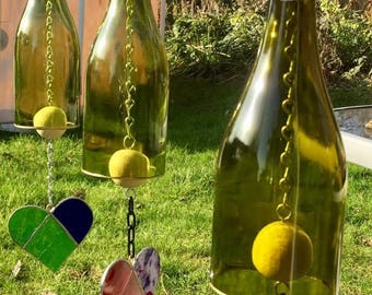 Bottle wind chimes with stained glass hearts