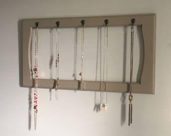 Beige jewelry hanger w/rose bronze hooks