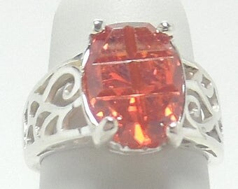 This is a beautiful 6 ct Oval CZ set in Sterling Silver. It is a size 9, but can be resized.