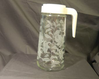 One Quart Tang Orange Juice Carafe with White Lilies  1970's