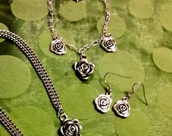 Silver rose necklace, matching earrings and bracelet