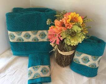 Decorative teal blue with peacock and Trim Towels