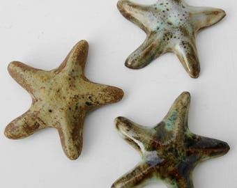 Three starfish fridge magnets