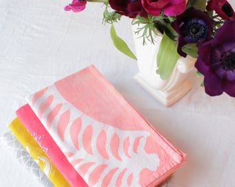 batik tea towel. tropical leaf grapefruit pink