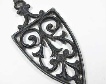 Vintage Cathedral Trivet Black Cast Medal Kitchen Decoration Worn Patina