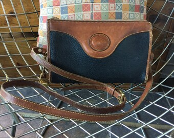 Authentic Vintage Dooney and Bourke all weather leather