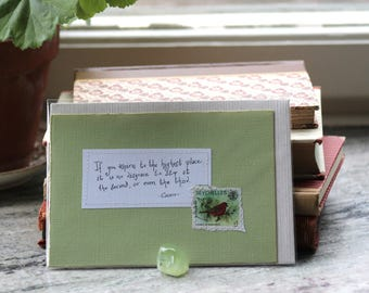 If you aspire to the highest place Pale green card with handwritten quote and bird postal stamp