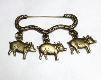 Three little pigs wearing bows charm bronze tone brooch/pin