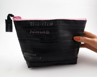 Recycled bicycle inner tube cosmetic pouch for men and woman, container, bag, with pale pink zipper.