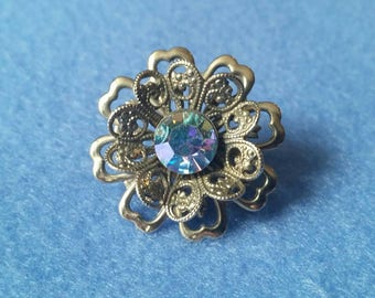 Vintage Rhinestone Filigree Flower Brooch, iridescent light blue rhinestone, silver tone lapel pin