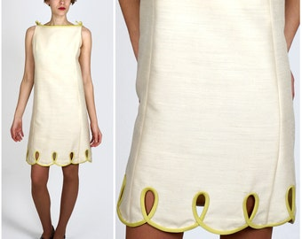 Vintage 1960s Ivory Sleeveless Mod Shift Dress with Lime Green Scalloped Peekaboo Cut-out Hem by Makoff | Small