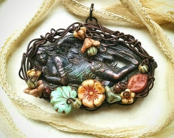 Angel in the garden, wire wrapped pendant with verdigris patina, lovely glass flowers