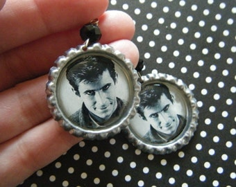 Norman Bates close up bottle cap earrings with black glass beads