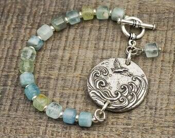 Bird and wave bracelet, light blue aquamarine beads, grateful heart, silver 7 1/4 inches