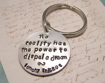 No Reality has the Power to Dispel a Dream Keychain. Lemony Snicket