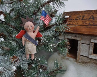 Patriotic Christmas Ornament Named USA Holding Flag