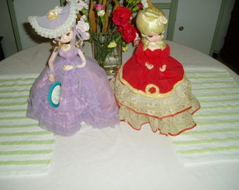 Two Vintage Bradley Dolls One in Purple Dress and One in Red Dress