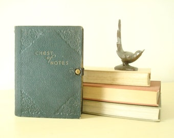 "Antique keepsake box, ""Chest of Notes"" book-style treasure box, grey box with gold embossing, cardboard with snap closure"