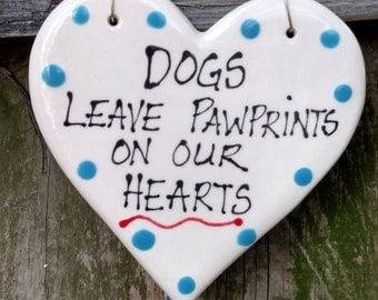Dogs leave pawprints on our hearts ceramic sign.