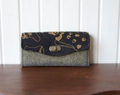 Necessary Clutch Wallet in Carkai metallic on black with black/gold metallic essex linen