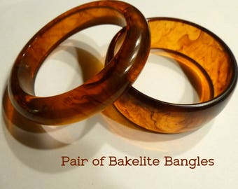 "Bakelite Bangle Bracelets. Translucent Amber Swirled Color ""Root Beer"". Vintage 1940s. Two Bracelets of Different Styles. Tested."