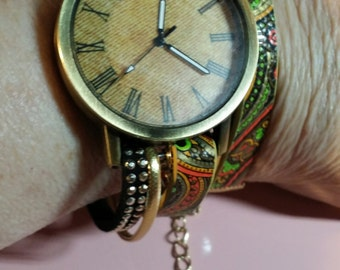 Wrap Watch with golds, reds, green and black bands; green and red crystal dangle