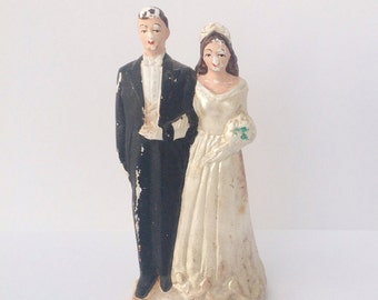 Vintage 1940s bride and groom wedding cake topper. Black and white.