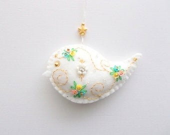 Felt Ornament White Bird Hanging with Little Cupped Flower Sequins Swirls and a Gold Plated Star Charm Handsewn