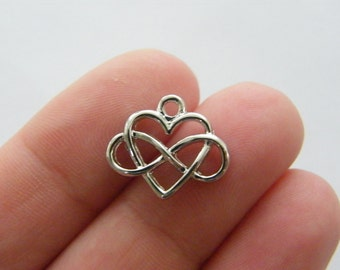 4 Infinity heart charms silver tone R69