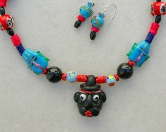 HUMOROUS Glass Face, Many Glass Face Beads, Onyx, Dyed Howlite, from the Faces Collection, Necklace Set by SandraDesigns