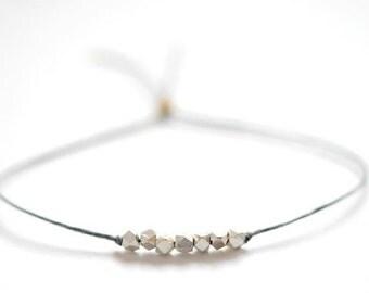 SALE Wish bracelet.  Silver nugget beads on Slate Gray Irish linen cord -simple bead bracelet