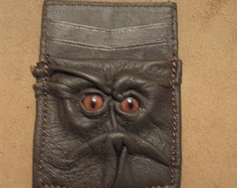 Grichels leather money and card clip - dark chocolate brown with rusty brown slit pupil fox eyes