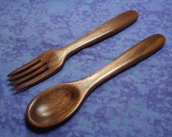Hand carved compact eating spoon and fork set in walnut wood