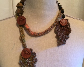 A Whimsical Necklace Beads Leaves and An Icord...Earth Tones