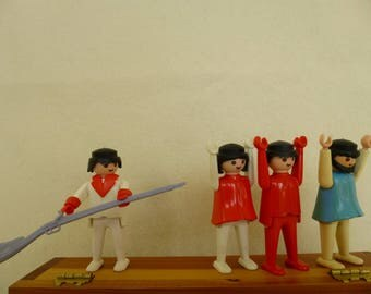 Group of Four Plastic Playmobile Figures (and One Gun)