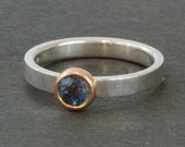 Montana blue Sapphire set in 14 karat yellow gold bezel on sterling silver band